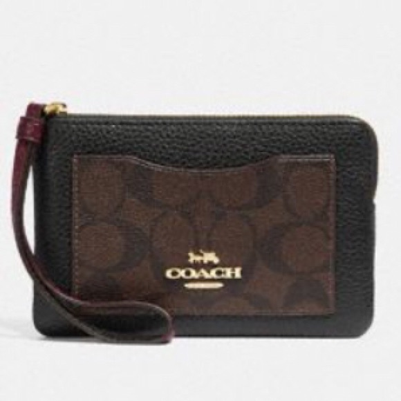 0e8034c56da7 Authentic Coach Corner Zip Wristlet  Price is Firm